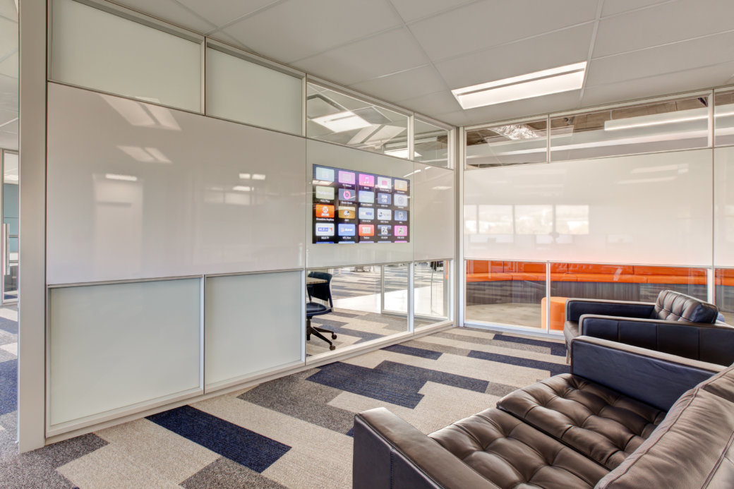 Glass technology and media wall by DIRTT in Utah office