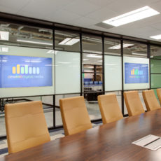 A conference room with media walls by DIRTT and modern conference table in Utah office