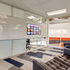 Glass technology and media wall by DIRTT in Utah office Thumbnail