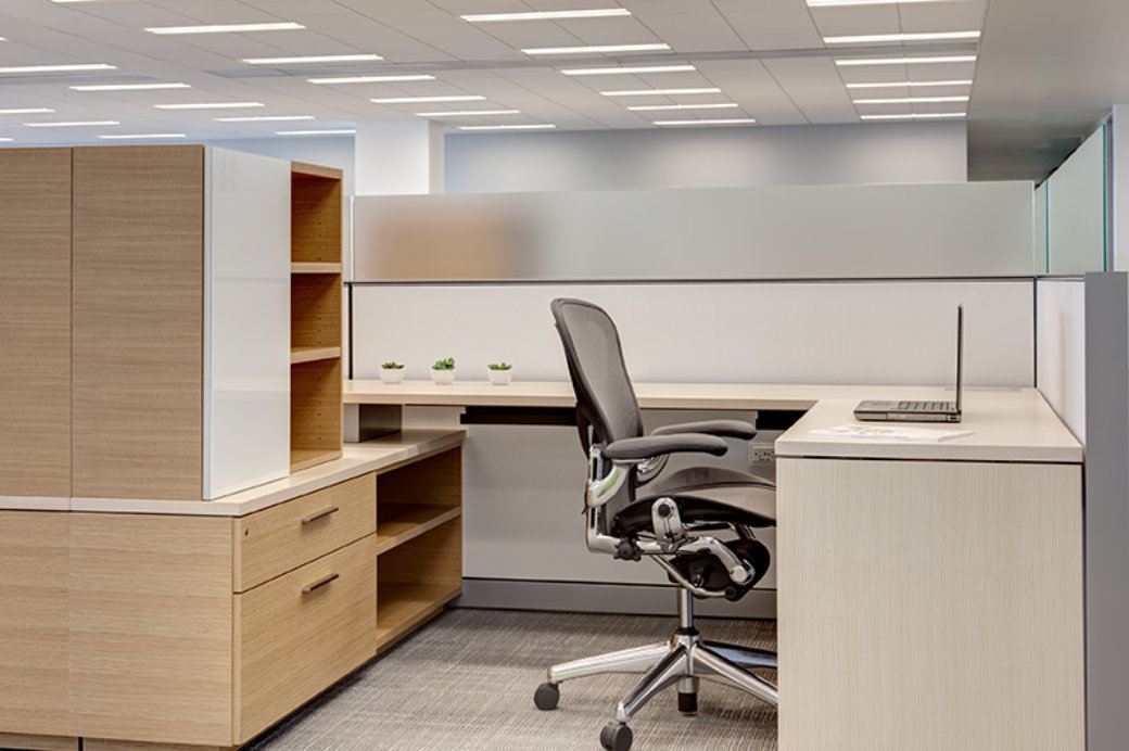 Aeron chair at wood workstation cubicle in Utah office