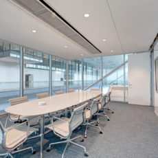Sleek white conference room table and conference chairs for Utah office