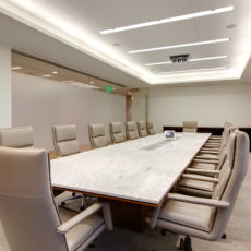 Marble conference room table with modern chairs in Las Vegas office Thumbnail
