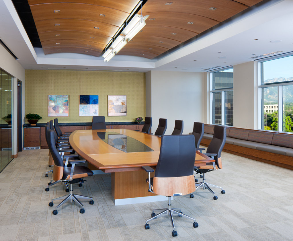 Spacious conference room with wood furniture in Salt Lake City office