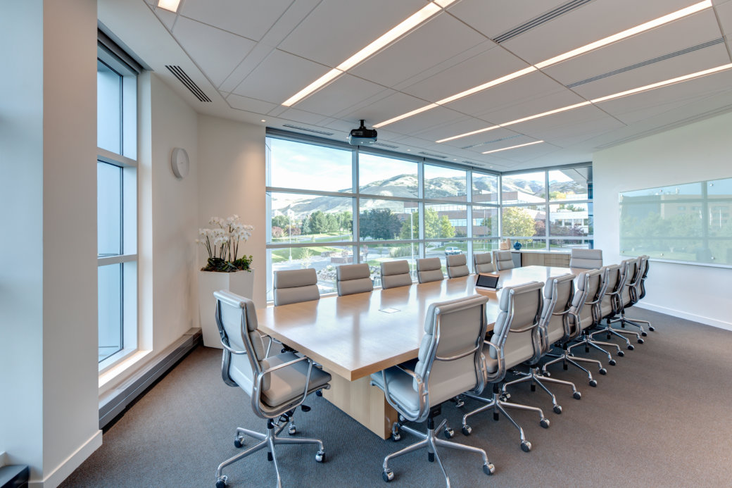 Sleek conference room furniture for Wasatch Advisors office in Utah